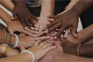 putting hands together, showing unity